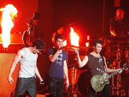 "Jonas Brothers performing ""Burnin' Up"" in 2010."