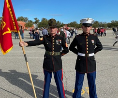 A new U.S. Marine stands with his Drill Instructor on graduation day.
