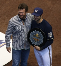 Braun accepts his 2011 National League MVP award from 1989 American League winner Robin Yount.