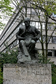 The Sigmund Freud memorial in Hampstead, North London, by Oscar Nemon. The statue is located near to where Sigmund and Anna Freud lived, now the Freud Museum. The building behind the statue is the Tavistock Clinic, a major psychological health care institution.