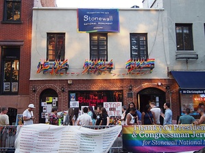 The Stonewall Inn in the gay village of Greenwich Village, Manhattan, adorned with rainbow flags during a pride event. The Inn was the site of the eponymous Stonewall riots in June 1969: a series of events which precipitated the modern LGBT rights movement. Stonewall has since become an icon of LGBT culture and gay pride in the United States.[172][173][174]