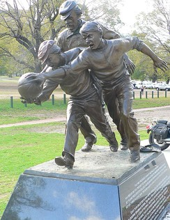 Statue of cricketer and Australian rules football pioneer Tom Wills umpiring an 1858 football match