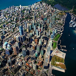 Aerial view of Downtown Vancouver. Urban development in Vancouver is characterized by a large residential population living in the city centre with mixed-use developments.