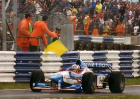 Alexander Wurz passes a yellow flag during the race.