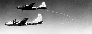 The US Airforce Boeing B-50 Superfortress, Lucky Lady II being refueled by Grappled-line looped-hose during the first non-stop circumnavigation of the world by air (1949)