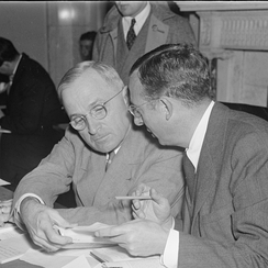 Counsel and chief investigator Max Lowenthal huddles with U.S. Senator and acting chairman Harry S. Truman on the Senate Committee investigating railroad financing, as it resumed its open hearings today, when Senator Truman was presiding for Senator Burton K. Wheeler.