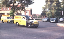 Two Evening News delivery vans cross the North Circular Road in Finchley, September 1975