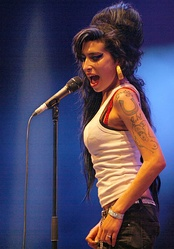 Following her death in July 2011, Amy Winehouse returned to number-one with Back to Black (2007) and again with the posthumous compilation Lioness: Hidden Treasures in December.