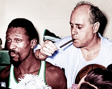 Russell and coach Red Auerbach with his trademark victory Blackstone cigar[56] after winning the 1966 NBA Championship
