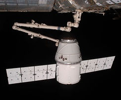The COTS 2 Dragon is berthed to the ISS by Canadarm2.