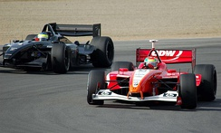Photograph of two race cars almost side by side on a track