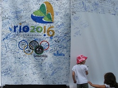 A young girl adds her signature in support of Rio de Janeiro's candidacy.