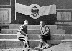 South African officers pose with a captured German flag in Windhuk.