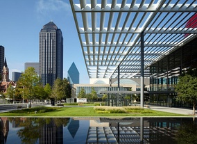 Pictured in the foreground is the Winspear Opera House with its reflecting pool and the Meyerson Symphony Center, both located within the Dallas Arts District.