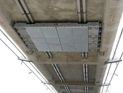 Single-tuned mass damper fitted to the underside of the concrete decking of the smaller arch of the bridge.