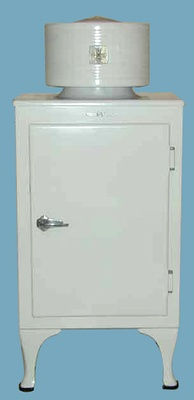 "General Electric ""Monitor-Top"" refrigerator, introduced in 1927, priced at $525, with the first all-steel cabinet, designed by Christian Steenstrup.[9]"