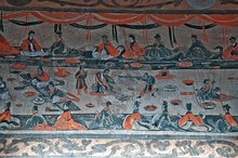 Left: a late Eastern Han (25–220 AD) Chinese tomb mural showing lively scenes of a banquet (yanyin 宴飲), dance and music (wuyue 舞樂), acrobatics (baixi 百戲), and wrestling (xiangbu 相撲), from the Dahuting Tomb (打虎亭漢墓; Dáhǔtíng hànmù), on the southern bank of the Siuhe River in Zhengzhou, Henan province (just west of Xi County)Right: a mural from an Eastern Han tomb at Zhucun (朱村), Luoyang, Henan province; the two figures in the foreground are playing liubo, with the playing mat between them, and the liubo game board to the side of the mat.