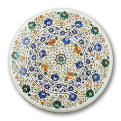 A marble table top in Pietra Dura, a craft practised since the Mughal era in Agra