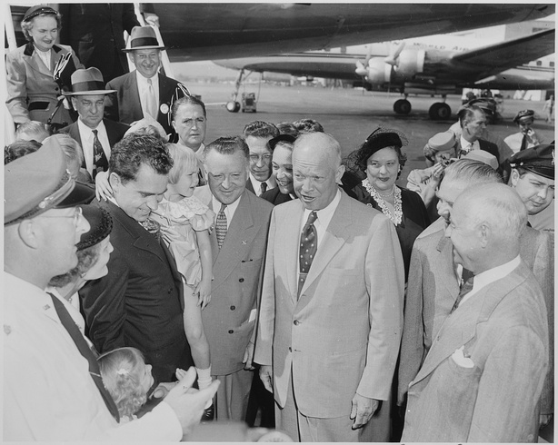 Richard and Pat Nixon introduce General Dwight D. Eisenhower—Richard Nixon's running mate—to their daughters Tricia (standing) and Julie (carried by her father), Washington National Airport, September 10, 1952.