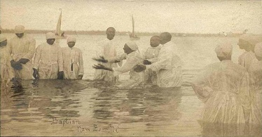 A river baptism in North Carolina at the turn of the 20th century. Full-immersion (submersion) baptism continues to be a common practice in many African-American Christian congregations today.