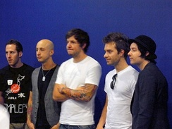 Simple Plan in Osaka in 2009. From left to right: Chuck Comeau, Jeff Stinco, Pierre Bouvier, Sébastien Lefebvre and David Desrosiers
