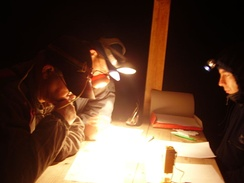 "Studying the map at the start of a night orienteering competition, or ""night-o"""