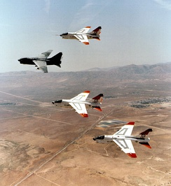 Prototype YA-7Ds 67-14582 and 67-14584, along with 69-6191 and 69-6217 making last flyover retirement formation over Edwards AFB, California, heading to AMARC, August 1992