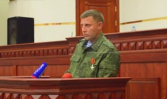 Aleksandr Zakharchenko takes an oath of office as the Prime Minister of Donetsk People's Republic, 8 August 2014 by ANNA News. In August too he said 1200 fighters trained in Russia for four months, crossed and were ready to fight. He said the reinforcements included 30 tanks and 120 armoured vehicles.[445]