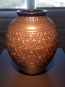 A ceramic vase inspired by motifs of traditional African carved wood sculpture, by Emile Lenoble (1937), Museum of Decorative Arts, Paris