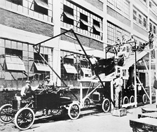 The Model T revolutionized transportation in the 1900s as well as increased production by use of the assembly line. Shown is a test of mounting the body on the chassis, which was actually done inside the factory by using an overhead crane.