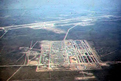 Camp Friendship viewed from the air in 1964 with Korat Air Base at the top of the photo, however much of the support base is not yet constructed