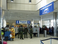 U.S. Border Patrol Agents at the Greyhound bus station in Detroit, Michigan in February 2011. Immigration checks on trains, buses, and highways within 100 miles of the northern border have become more common.[24]