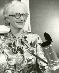 Dr. Nancy Grace Roman with a model of the Large Space Telescope that was eventually developed as the Hubble Space Telescope. While listed as a 1966 photo, this design was not the standard until the mid-1970s.