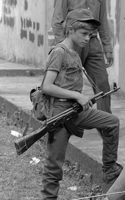 Rebel Salvadoran soldier boy combatant in Perquin, El Salvador 1990, during the Salvadoran Civil War.