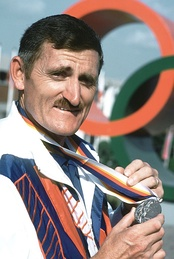 Erich Buljung shows a silver medal he won in the 10m air pistol competition at the 1988 Summer Olympics.