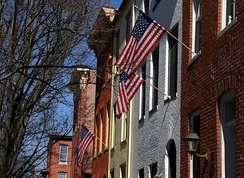 Brick rowhouses with flags