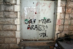 """Gas the Arabs""; graffiti on the door of a home in Hebron, 2008"