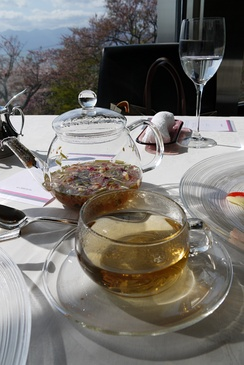 Herbal tea in a glass teapot and cup