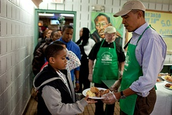 President Barack Obama serving lunch at a Washington soup kitchen on MLK Jr. Day, 2010