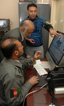 A NATO mentor trains two broadcasters on video editing and storytelling techniques.