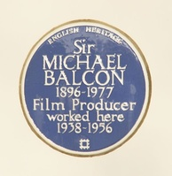 English Heritage blue plaque on the front wall of the White Lodge at Ealing Studios, Ealing Green.[3]