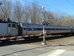 A Northeast Regional train crosses Miner Lane in Waterford, the site of a fatal accident in 2005