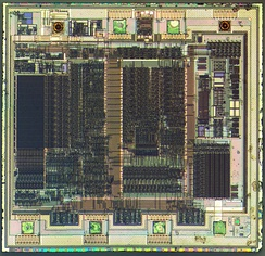 Die of a PIC12C508 8-bit, fully static, EEPROM/EPROM/ROM-based CMOS microcontroller manufactured by Microchip Technology using a 1200 nanometre process