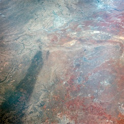 This image of Texas, obtained by astronauts aboard NASA's Gemini 4 spacecraft shows a large dark swath attributed to rainfall.
