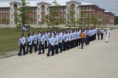 "Recruits march from their ""ship"" barracks named for USS Chicago (SSN-721)"