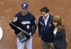 Braun accepting his 2011 Silver Slugger Award from Brewers owner Mark Attanasio