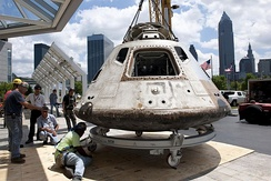The Apollo Command Module of the 1973 Skylab 3 mission being moved to the Great Lakes Science Center