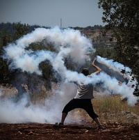 Tear gas grenade returned to Israeli soldiers using sling during Palestinian weekly protest in Ni'lin, July 2014