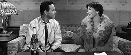"Calvin Clifford ""Bud"" Baxter (Jack Lemmon) and Fran Kubelik (Shirley MacLaine), in a still from the film's final scene: ""Shut up and deal."""