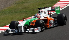 Liuzzi driving for Force India at the 2009 Japanese Grand Prix